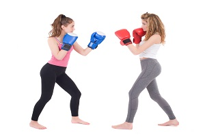 28464267 - kickboxing girls fight isolated on a white background studio shot